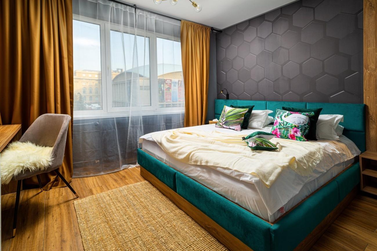 dormitor apartament în stil industrial